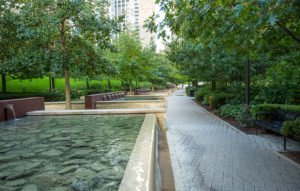 Botanical park featuring cascading waterfalls at the site of a completed Magellan real estate development site.